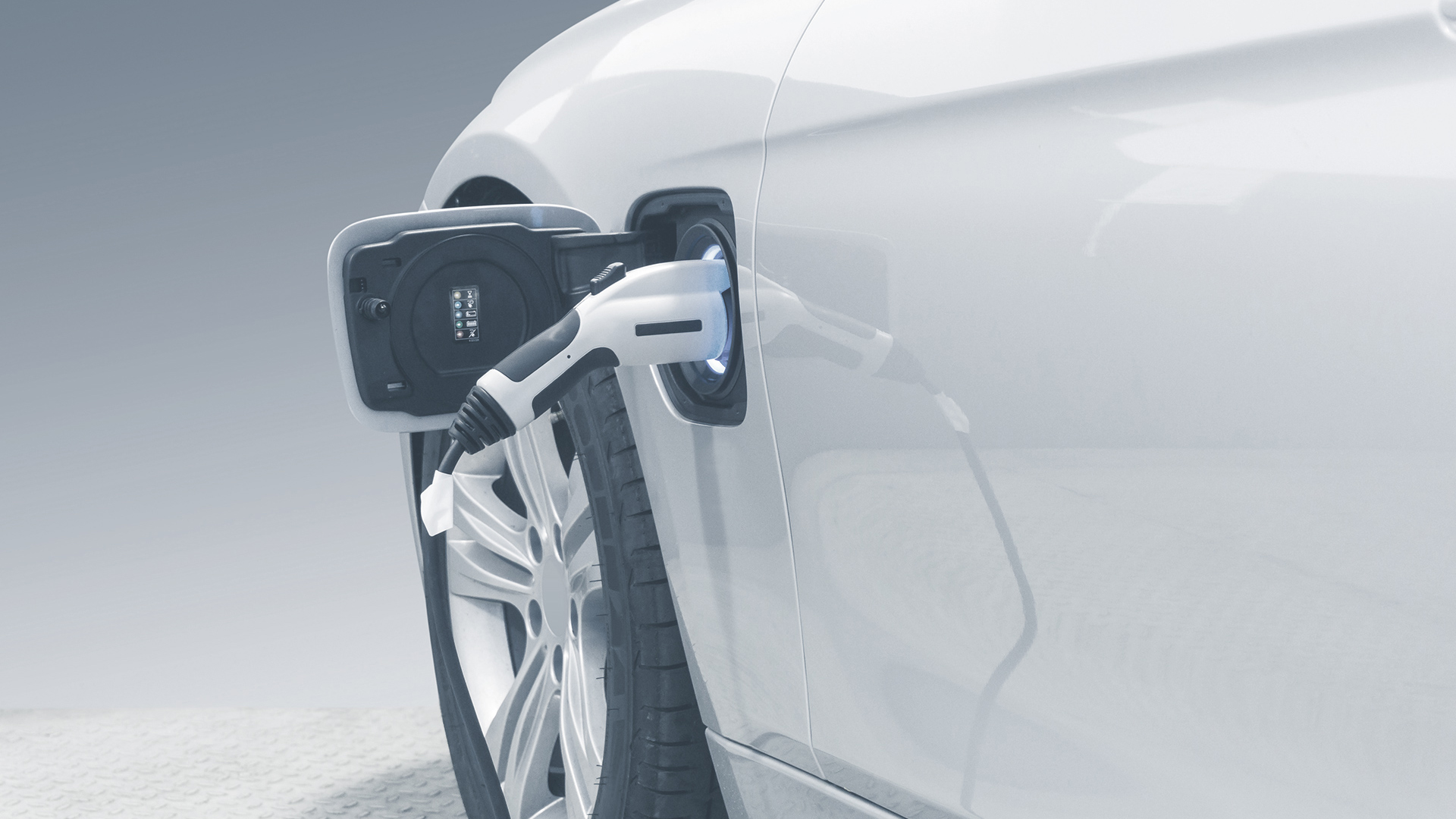 EV Car or Electric car at charging station with the power cable